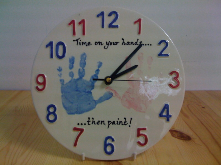 Painted baby handprints footprints babies prints for Handprint ceramic plate ideas